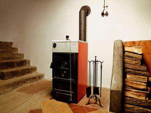 Отопление дома с помощью твердотопливного котла